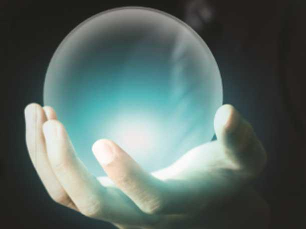 Hand holding crystal ball 1